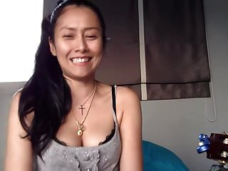 Thai Girl Show Her Cleavage While Singing