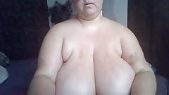 MILF in glasses with huge natural tits showing