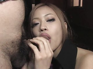 Japanese beauty sucks a thick hard dong in the dark