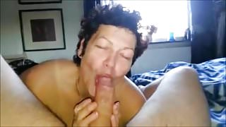 she is enjoying sucking on a large one
