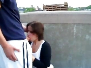 Horny brunette blows a big dick outdoor with facial
