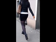 #91 Woman with sexy legs in mini skirt and black tights