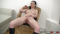 Hot babe in boots plays with her pussy