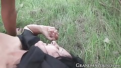 Lascivious granny dicked in nature by young stud