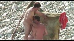 guys sucking on the beach