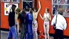 3 Girls Stripping in front of a crowd