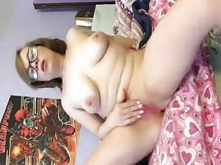 Naked nerdy brunette fucks herself with dildo