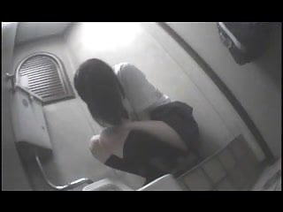 Japanese schoolgirl rubs herself through her panties