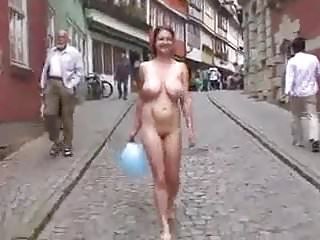 Pretty woman with giant huge saggy boobs naked on the street