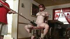 Tied and gagged redhead toyed on a chair