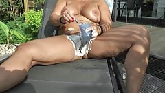 Busty blonde shaves her pussy outdoors