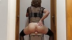 Crossdresser riding big dildo