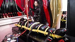 Mistress Kim using Serious Kit on her rubberslut