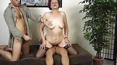 German granny enjoys threesome