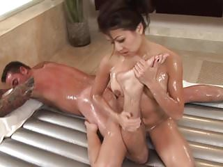Sexy asian cuty gives oil massage and worships white cock