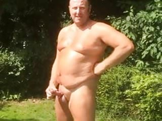 Outdoor wank in the sunshine at nudist club