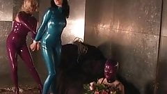 Slut in blue latex suit gagged