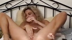 Dirty MILF slut with huge dildo and fist in her lose pussy