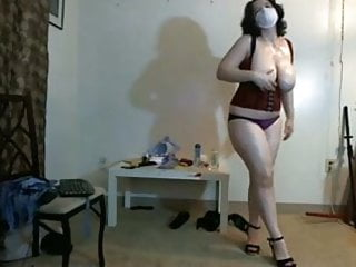 Busty, chubby girl in mask dancing on webcam