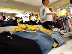 Candid voyeur teen shopping in tiny camo shorts
