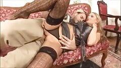 Lovely blonde MILF in designer stockings grabs his cock