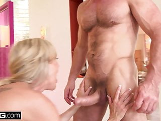 dude penetrates wet pussy on the black couch
