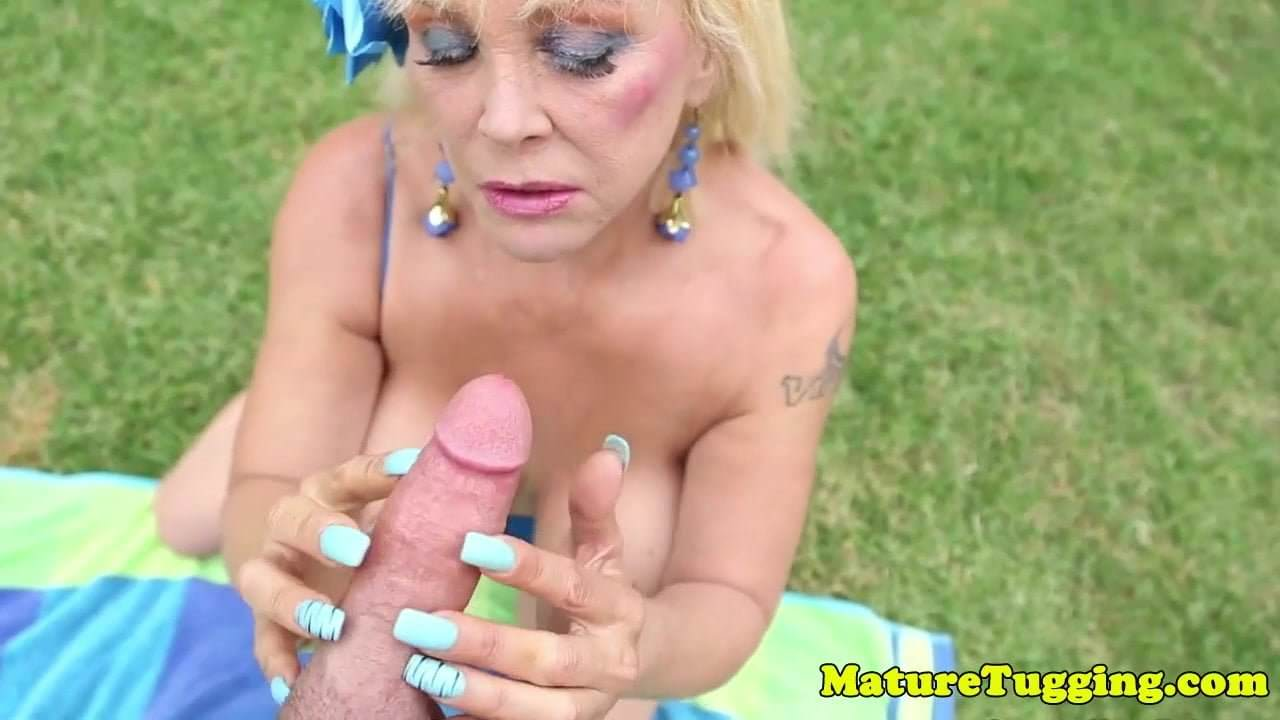 Mature women tugging