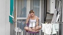 Teen neighbor shows upskirt on the balcony