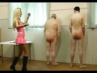 Hot Dominatrix in Pink Latex Works Over Her Two Slaves