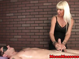 Mature masseuse tugging during hj massage
