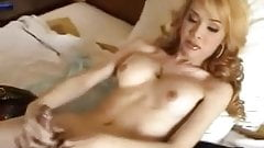 Gigi  Sexy gorgeous trany stroking her large clit-cock