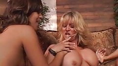 Busty brunettes have wild lesbian session on a couch