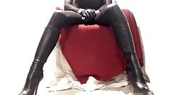 Kinky crossdresser playing in boots and nylon
