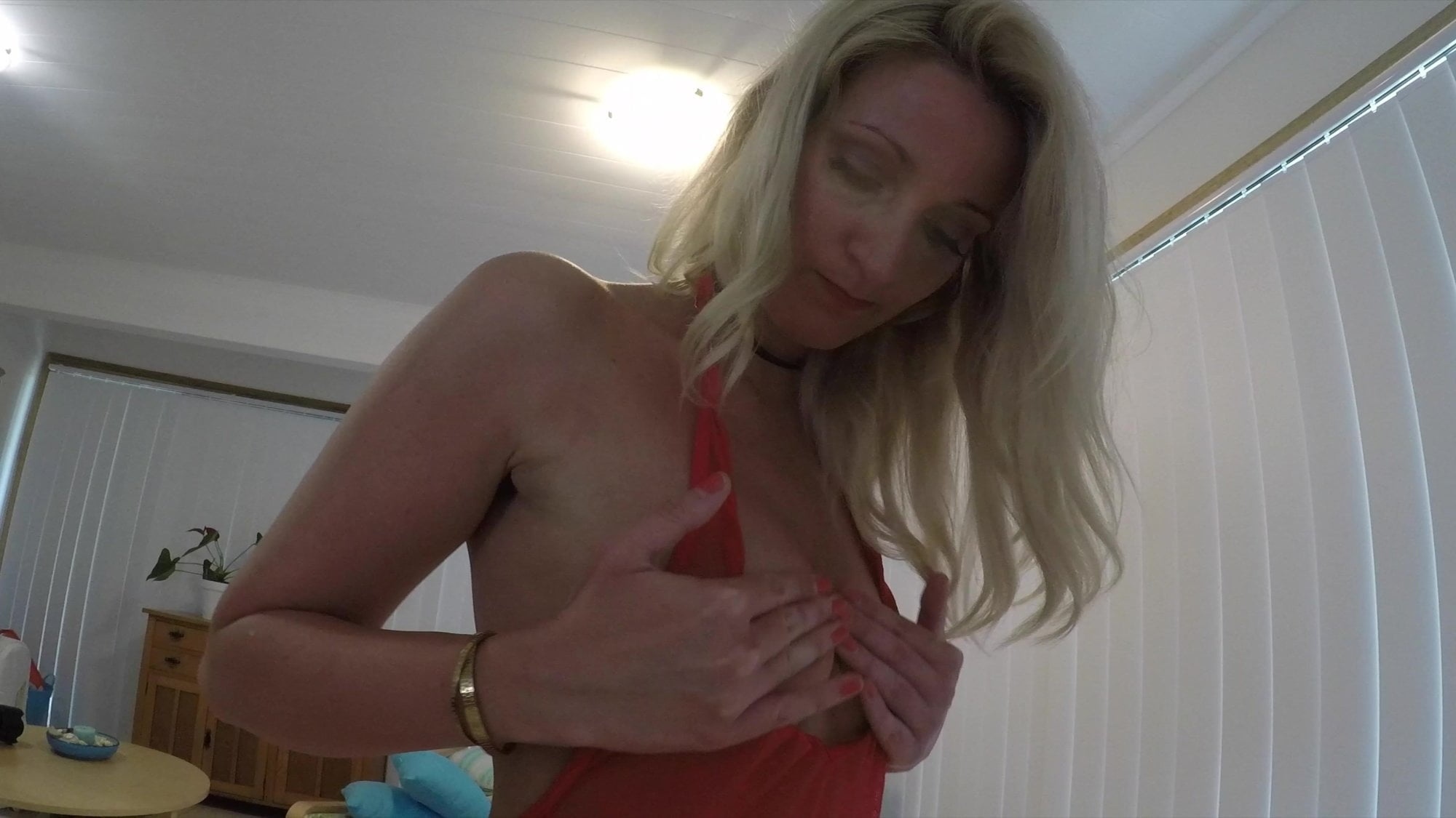 Blonde MILF getting fucked on couch and receiving a big load