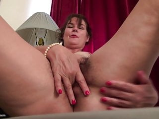 Hairy mature mother feeding her wet pussy