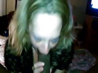 White MILF sucking a hung black cock