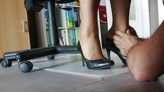 Nylon feet love in the office under the desk