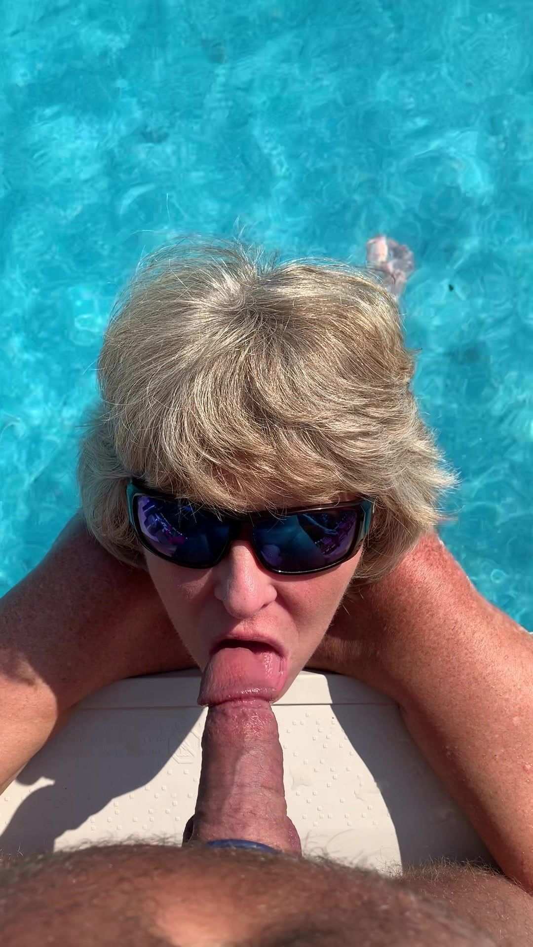 Blowjob by the pool