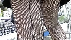 Seamed fishnet stockings in market