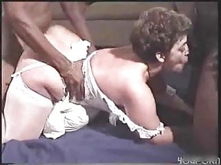 The big-assed MILF takes on two black cocks