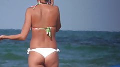 Sexy Babe Undressing At The Beach