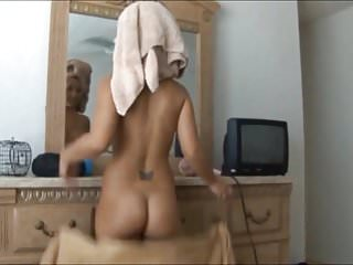 She drops the towel to reveal her butt.