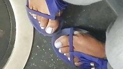 Shy candid ebony feet on bus