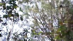 Outdoors young boy saws on cam