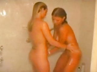 Two amateur teens showering together