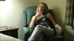 Mature blonde smoking in hotel