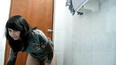 Second time secretary masturbates in public toilet