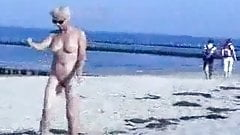 Cute hot granny fully naked at beach. Public nudity