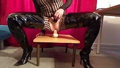 Slave slut rides huge dildo in crotch boots