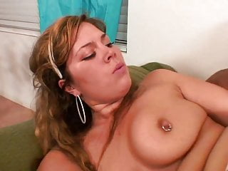 Young cutie is on her knees blowing long black cock